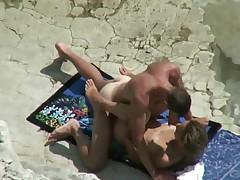 Couple spyed on a beach
