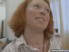 Pierced redhead stretched out