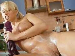 Dildoing With Insanely Huge Dildo In A Kitchen