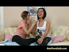Teen lesbians strap on the fun