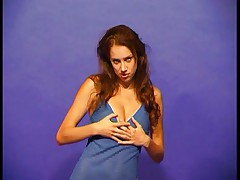 Young brunette strips
