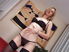Hot blonde gets a fist in her pussy