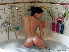 Sexy girl having fun in bathtub