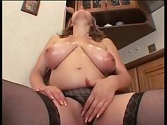 Big breasted pregnant woman masturbating