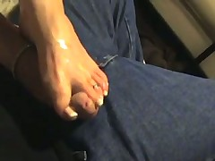 Amateur gives footjob to her boyfriend