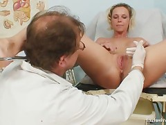 Hot Gabriela getting naked in gyno office