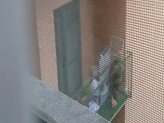 I see a woman on balcony