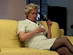 Granny masturbating on sofa